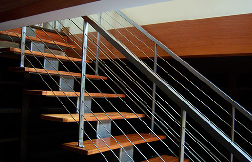Iron staircase with wire accents